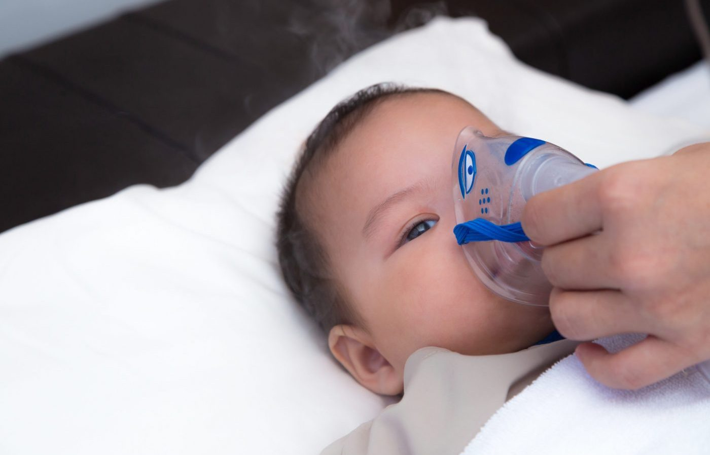 5 months old baby with respiratory syncytial virus, inhaling medication through inhalation mask